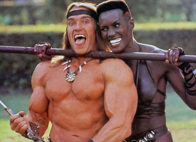 arnold and grace jones behind the scenes of the movie Conan